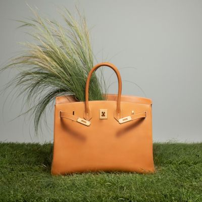 94dcad5df401 This grained leather gets a beautiful patina over time. The Birkin bag in  natural cowhide comes exclusively in natural sand.